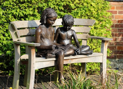 Bronze sculpture of children reading.JPG