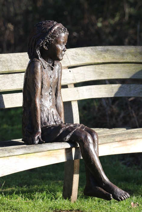 Ellie sitting girl sculpture 1.JPG