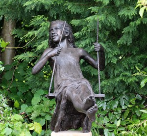 Girl on swing sculpture