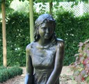 bronze sculpture girl with book