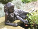 garden sculpture child with water